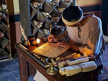 An ancient scribe writes on a scroll.