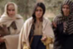 Mary Magdalene approaches Jesus' tomb with two other women before seeing him resurrected.