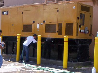 Field applicators ar applying a Component Coat to the generator exterior.