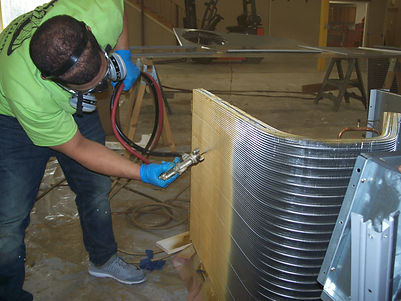 A field applicato applies HVAC protective coating to an HVAC coil.