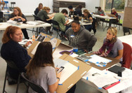 Students working during a drawing workshop.
