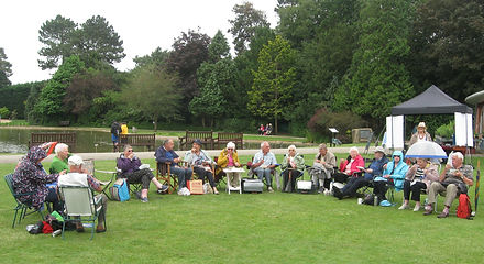 The Forty Plus Group meet in a park for a picnic lunch