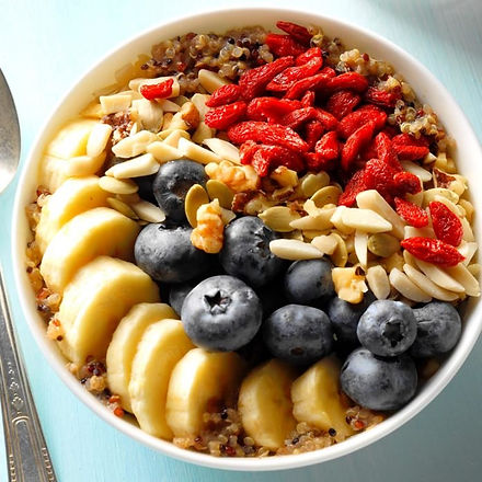 Bowl of breakfast cereal with assorted fresh fruit