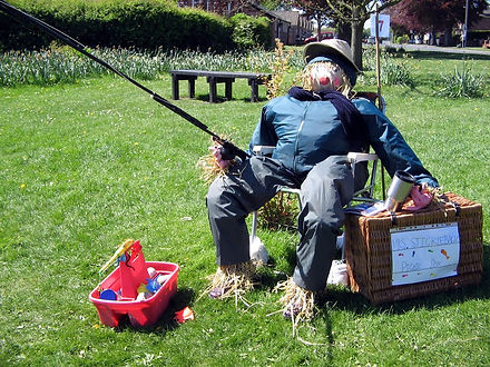 A scarecrow in someone's garden; one of many from our annual Scarecrow Festival.