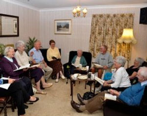 Members of a House Group, meeting in a member's home