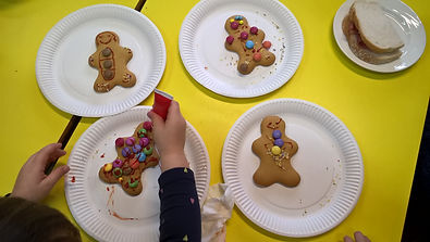 A child decorates gingerbread people at the Tuesday Night Troup (TNT) at HWMC.
