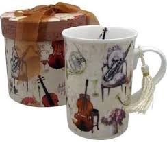 Prefer a mug to a cup and saucer? The same elegant music theme gift box makes it easy to give! The 10 ounce mug is 4 inches tall - Look for the violin inside!