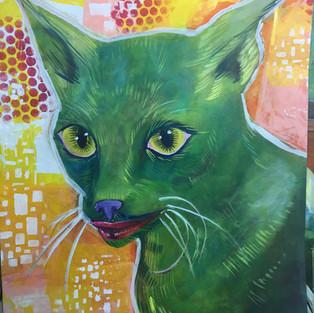 green smiling cat cheshire cat