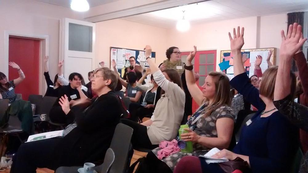 ladies raising hands
