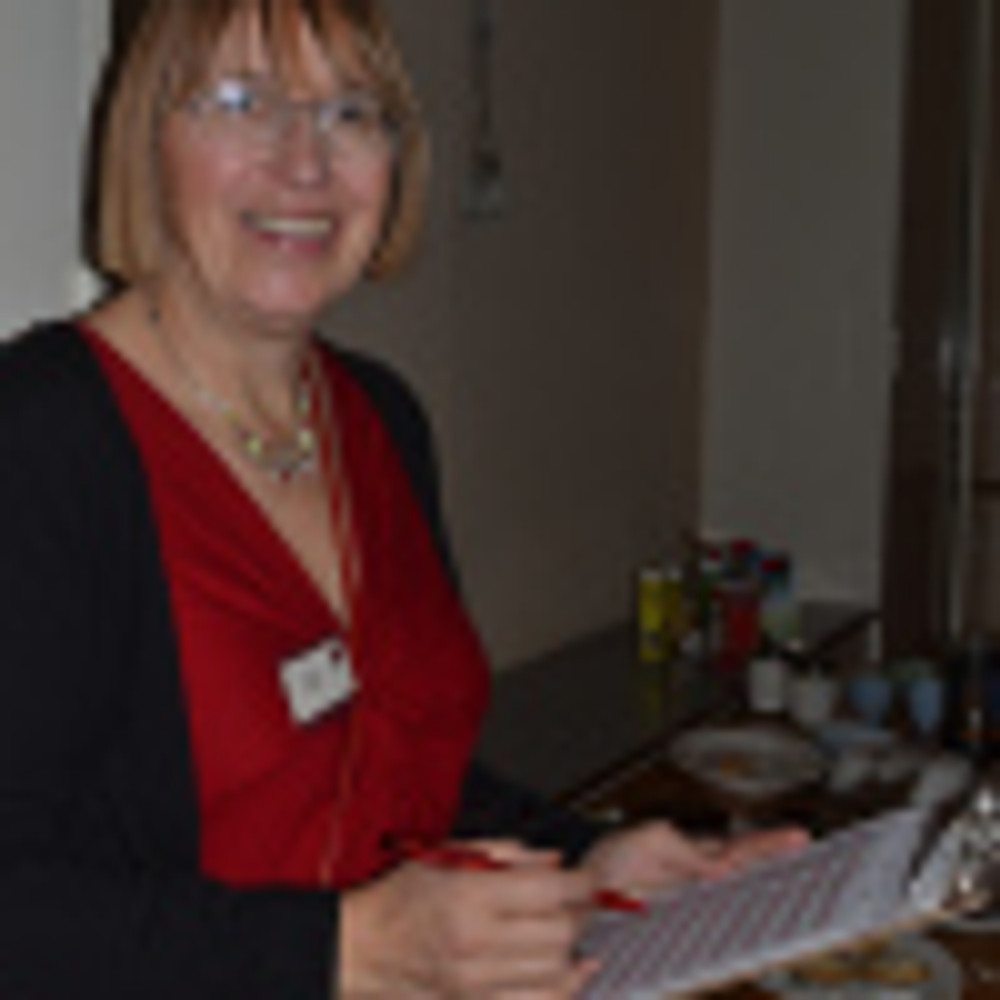 Sue has a clipboard-she needs bakers for 2015...