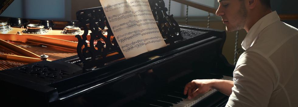 Musician playing piano.jpg
