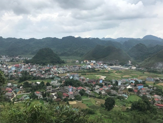 Ha Giang, Vietnam. Small village in a beautiful valley surrounded by green hills, mountains and unique topography.