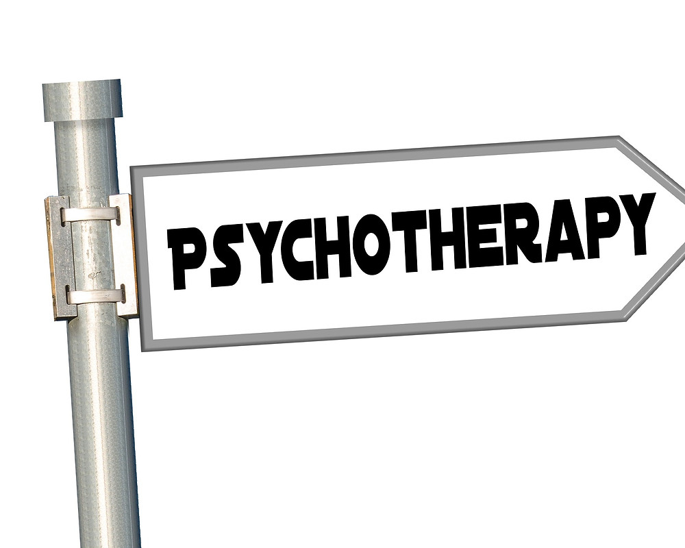 Street sign with the word 'PSYCHOTHERAPY'