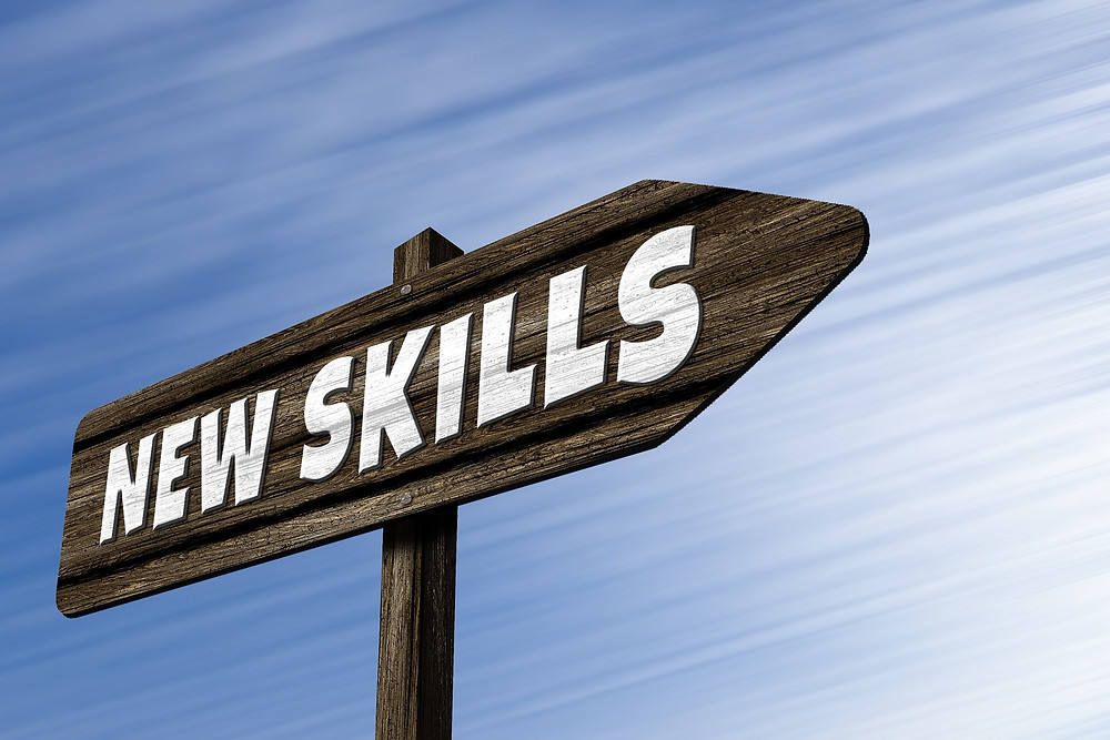 street sign reading 'new skills.'