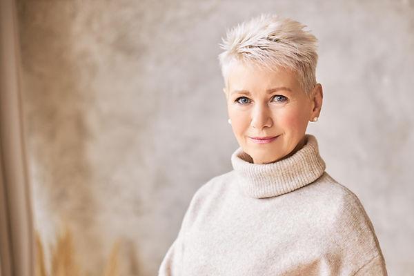 beautiful-happy-retired-woman-wearing-cozy-sweater-short-hairdo copy sm.jpg