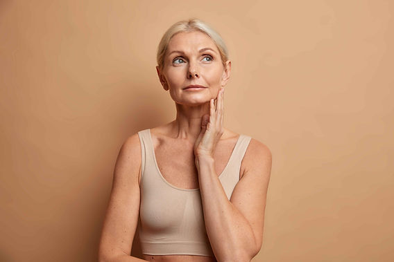 woman-touches-skin-after-applying-anti-age-cream-concentrated-with-thoughtful-expression-w