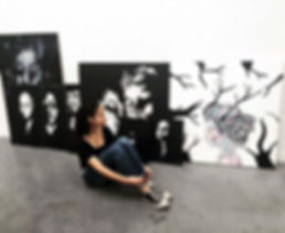 Artist Millie MacDougall and some of her original acrylic on canvas paintings