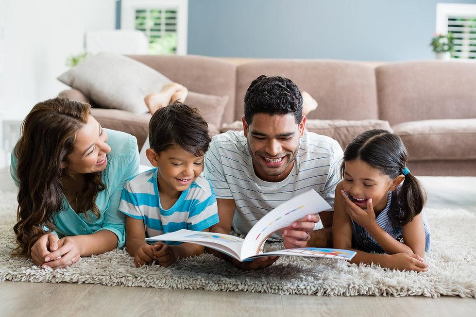 family-reading-book-on-floor.jpg