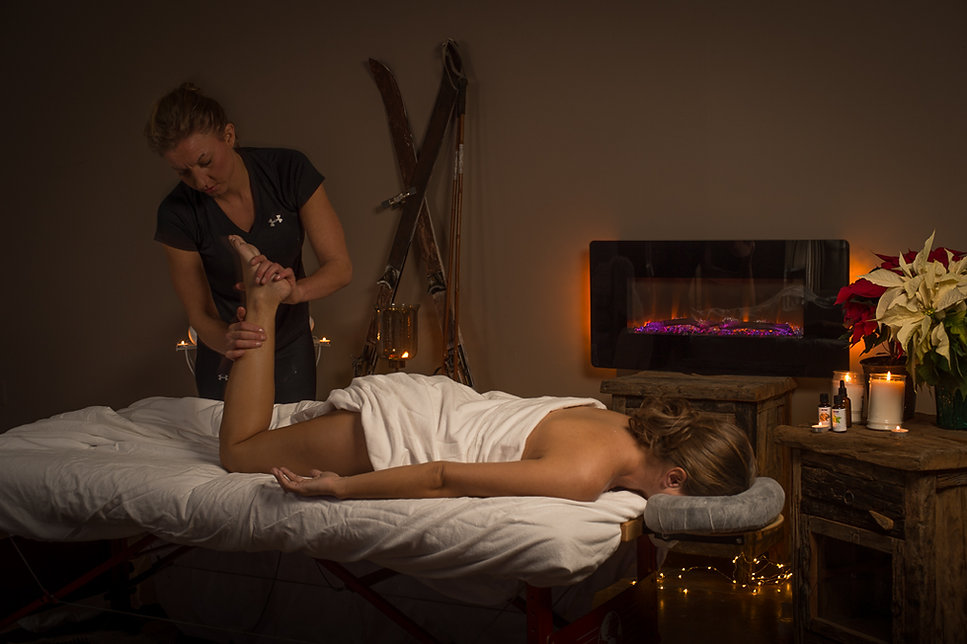Heather Reddig business owner of Massage & Wellness offers sports massage therapy for her clients.