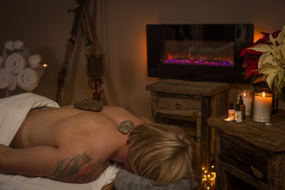 Heather Reddig busness owner of Massage & Wellness of Kalispell,MT offers hot rock massage therapy.