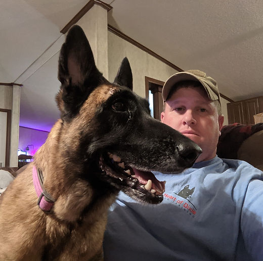 Ken Lebowtz owner of Heart of Dixie Dog Training with one of his dogs, Daisy, a Belgian Malinois