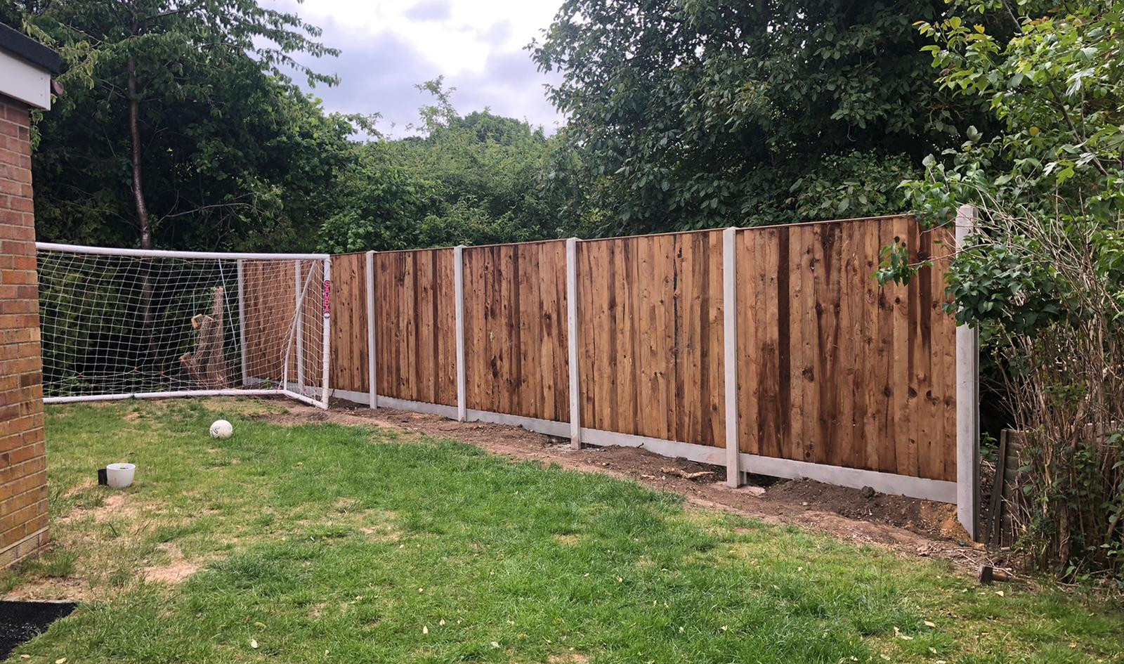 Concrete fence posts with wooden fence panels