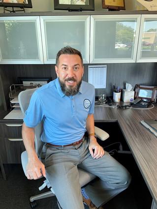 Daniel looking good in his Capstone golf shirt!