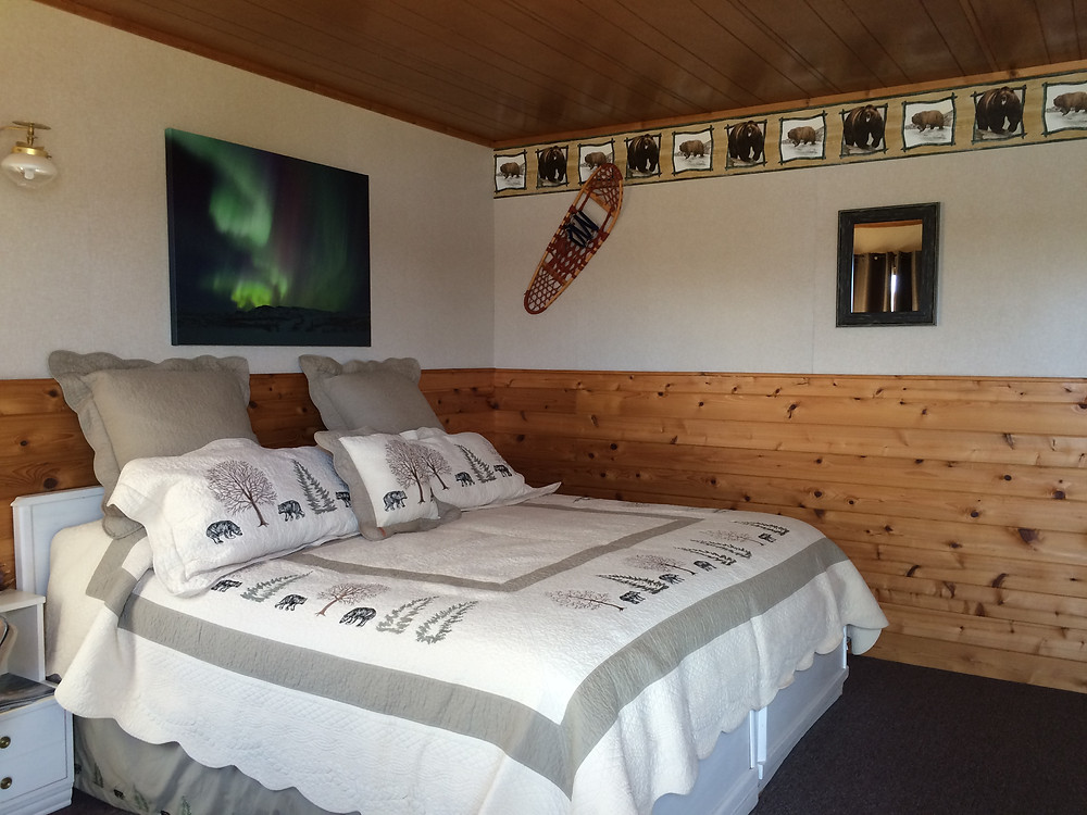 Inside one of our guest cabins set up with a king size bed