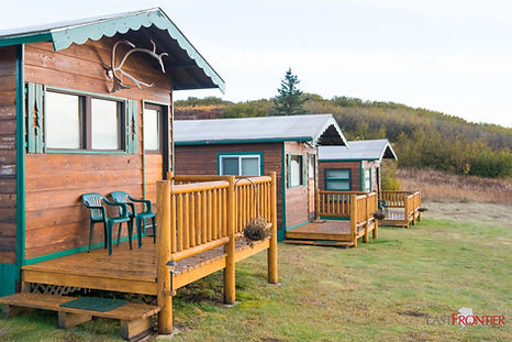 The 3 guest cabins at Caribou Lodge. Each cabin overlooks the lake.