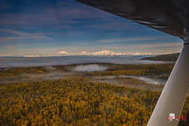The view of Denali from a bush plane as clients leave the fly in destination of Caribou Lodge Alaska