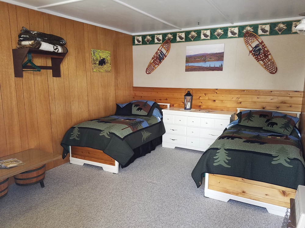 A Guest Cabin at Caribou Lodge Set Up With Twin Beds