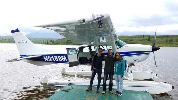 guests standing in front of float plane
