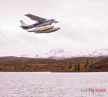 An iconic Alaska Float Plane takes off from the lake at Caribou Lodge Alaska and flies back to Talkeetna.