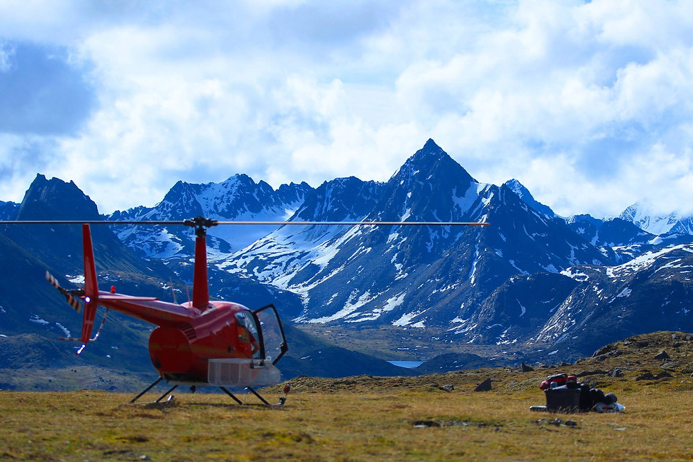 A helicopter in the Alaska mountains dropping us at our campsite