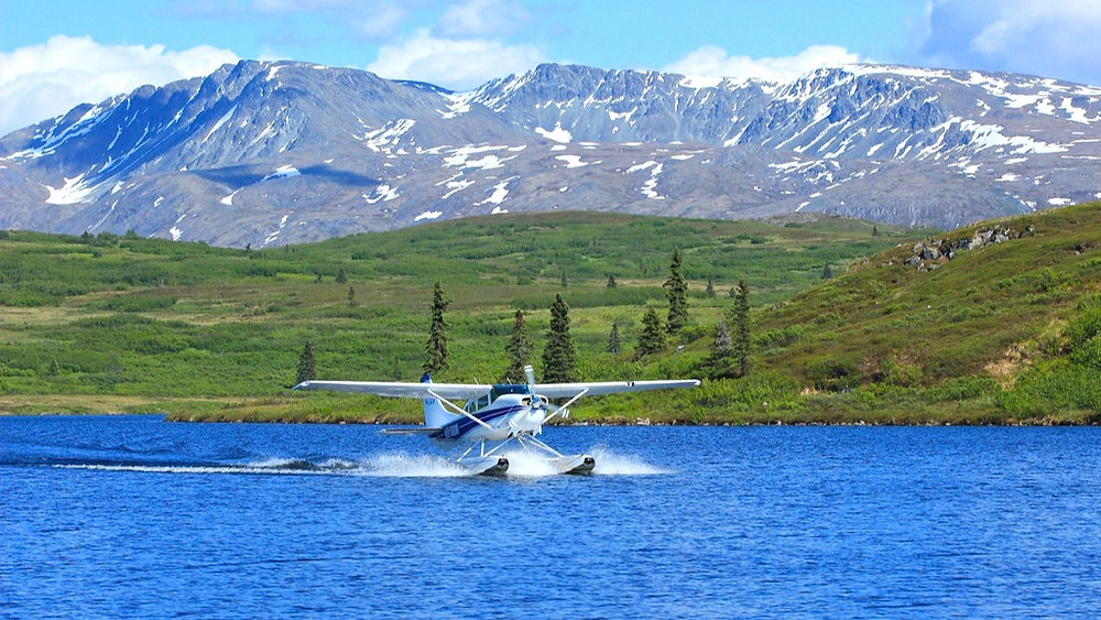 A Float-plane Landing on a remote lake at a Fly in wilderness lodge Caribou Lodge Alaska