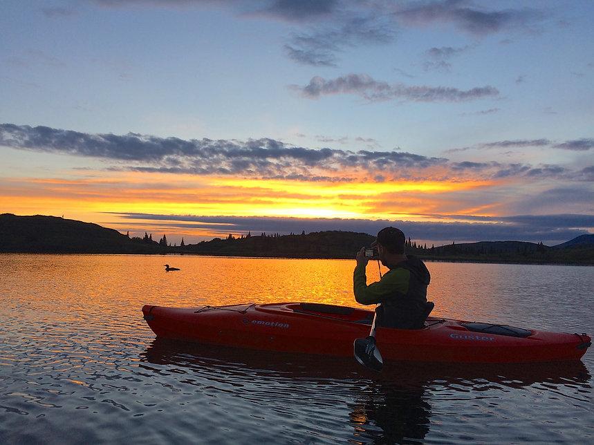 Kayaking on a pristine alpine lake at Caribou Lodge near Talkeetna Alaska