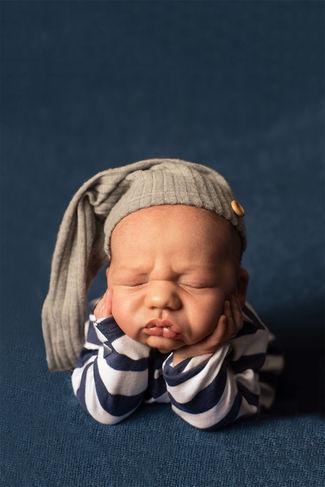 Newborn in froggy pose