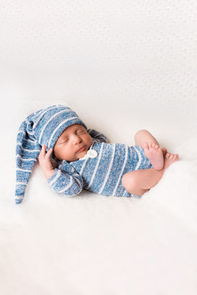 sleepy newborn pose