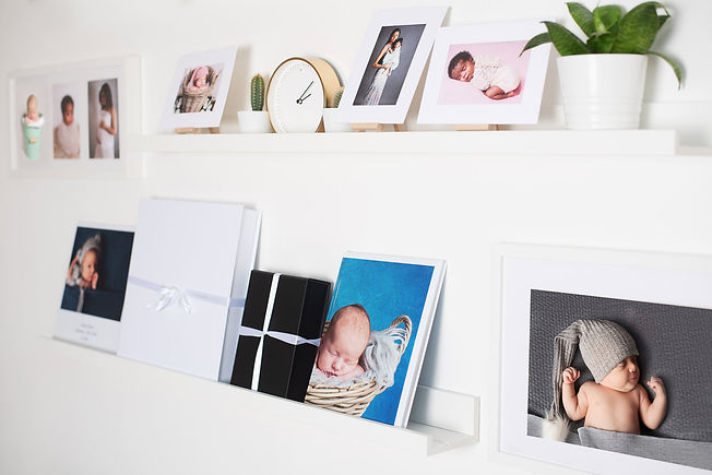 this photo shows the photobooks that I sell to clients this photo shows the inside of my studio