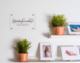 photo of my photography studio photo shelf and business sign along withsome plants