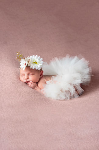 Baby girl sleeping in a tutu