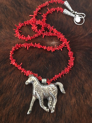 Silver horse on corral