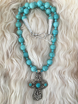 Silver andTurquoise Cross on Turquoise.