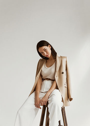 girl in a beige jacket fashion on a white background.jpg