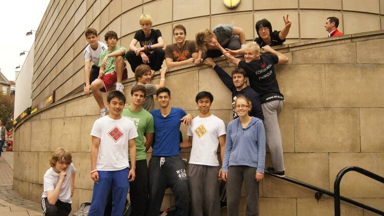 A group photo from a parkour jam, with about a dozen people.