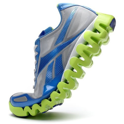 A single, expensive and high-tech looking running shoe, posed dynamically