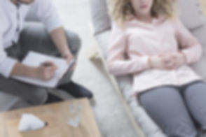Woman in hypnosis lying on psychotherapi