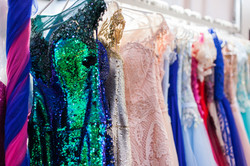 Rack with beautiful evening dresses in t