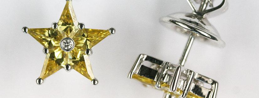 """Ohrstecker /750 Weissgold, """"Stern"""" 10 eingeschl. gelbe Safire 1.46 ct., 2 Diaman"""
