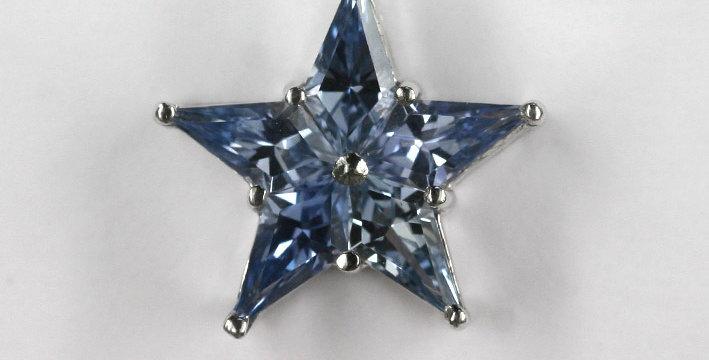"""Anhänger, ohne Schlaufe /750 Weissgold """"Stern"""" 5 eingeschliffene hellblaue Safir"""
